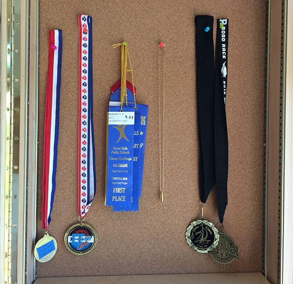 Urn jewelry hanging in a shadow box or trophy case